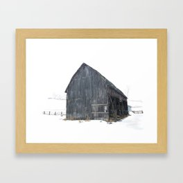 Old barn in the snow Framed Art Print