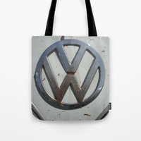 vw bus Tote Bags featuring Rusty VW Bus Symbol by wildVWflower