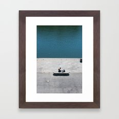 The reader and the river Framed Art Print