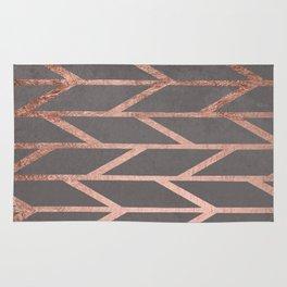 Rose gold chevron stripes geometric pattern on grey cement concrete Rug
