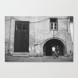 Children playing ball on the street  Canvas Print