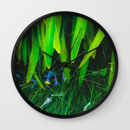 closeup green leaves plant with green grass Wall Clock