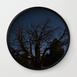 Moon brings life to an old tree Wall Clock