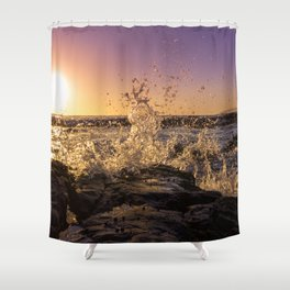 Magical sunset and waves breaking over rocky beach Shower Curtain