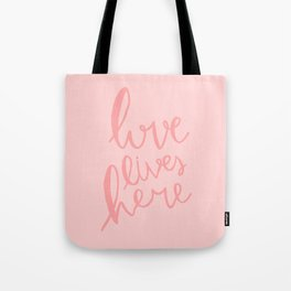 Love lives here - pink hand lettered typography Tote Bag