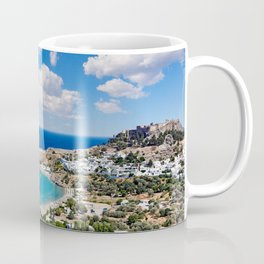 The village of Lindos with a beautiful bay, medieval castle and pictursque houses in Rhodes, Greece. Coffee Mug