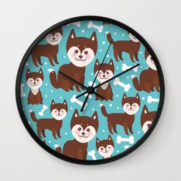 funny brown husky dog and white bones, Kawaii face with large eyes and pink cheeks blue background Wall Clock