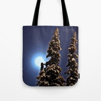 finland Tote Bags featuring Moonlight in Lapland, Finland by Guna Andersone & Mario Raats - G&M Studi