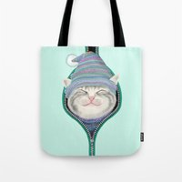 yetiland Tote Bags featuring Cat in the zip by Tummeow