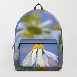 Daisies on a sunny summer day with blue sky Backpack