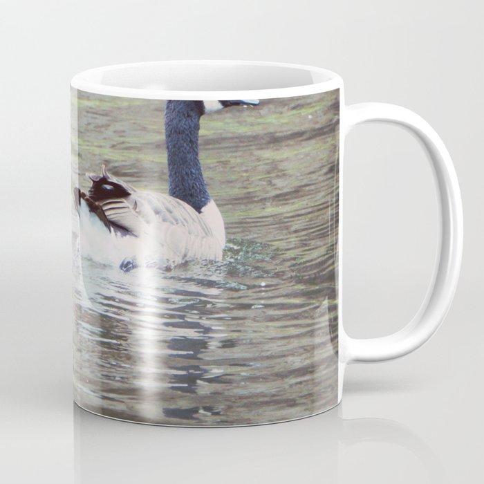 Goose on the lake. Coffee Mug