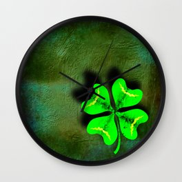 Four Leaf Clover on Green Textured Background Wall Clock