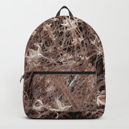 blooming dry plant with brown dry grass field background Backpack