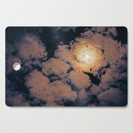 Full moon through purple clouds Cutting Board