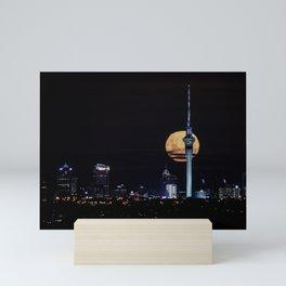 Moon rising through Sky Tower Mini Art Print