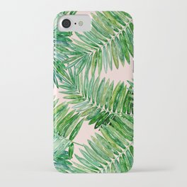 Green palm leaves on a light pink background. iPhone Case