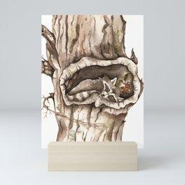 Sleeping Raccoon in Tree Hollow Mini Art Print