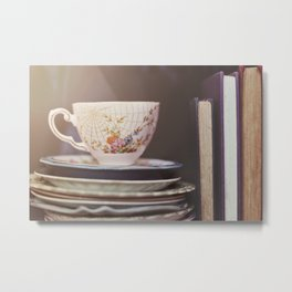 Vintage teacup and old books Metal Print