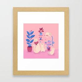 Grumpy mom and mischievous kittens Framed Art Print