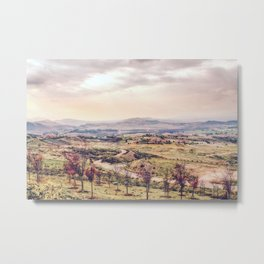 countryside view with sunset sky and green field with mountain view Metal Print