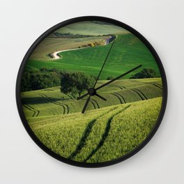 Curves and lines in the green fields of Tuscany Wall Clock