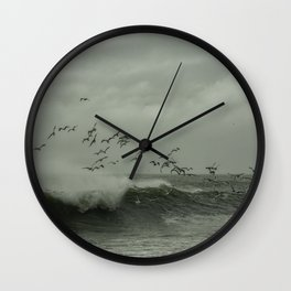 Birds dancing in the waves Wall Clock