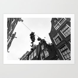 Hanging shoes in Amsterdam Art Print