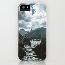 Mountains under cloudy sky iPhone Case