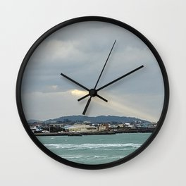 The sunlight shining through the clouds over the jeju sea village , Jeju Island, Korea. Wall Clock