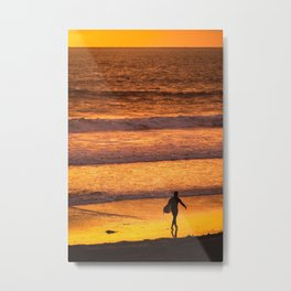 Surfer walking along beach at sunset Metal Print