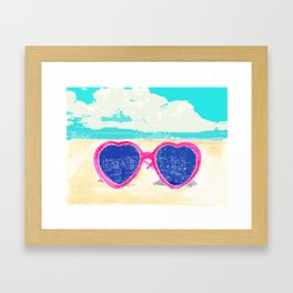 Sunglasses on beach Framed Art Print