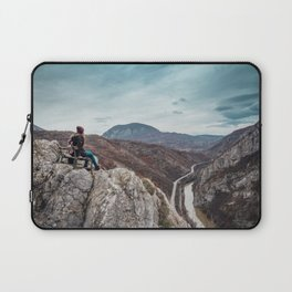 Girl sitting on the bench on the edge of the canyon with amazing view in front of her Laptop Sleeve