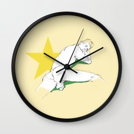 Nude male on pale yellow background Wall Clock