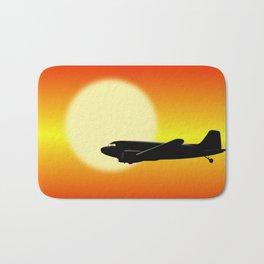 DC-3 passing sun Bath Mat