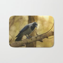Crow on the branch Bath Mat