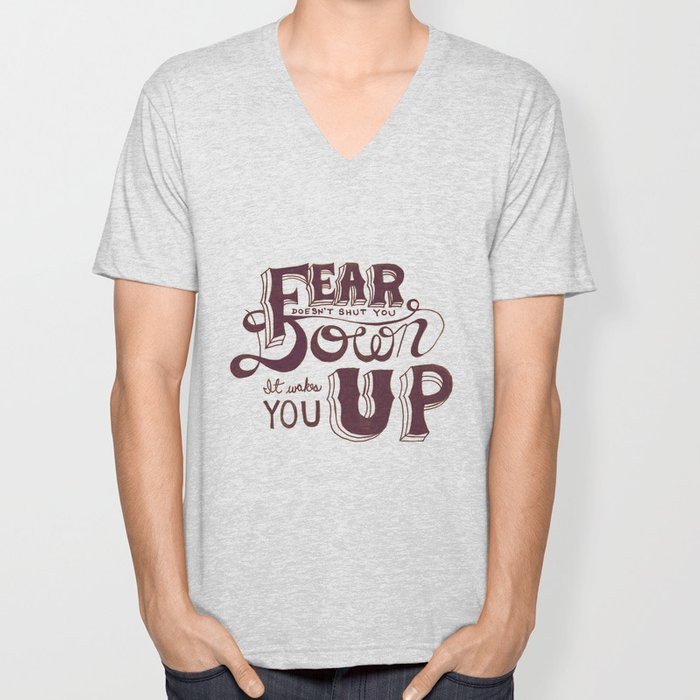 Fear doesn't shut you down; it wakes you up Unisex V-Neck