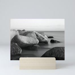 Stones in the sea Mini Art Print