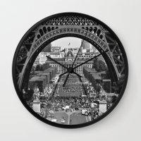 eiffel tower Wall Clocks featuring eiffel tower by AnnaGo