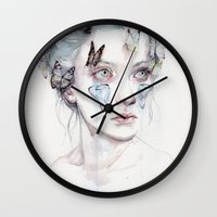 agnes cecile Wall Clocks featuring love and sacrifice by agnes-cecile