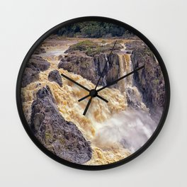 Powerful water going over the falls Wall Clock