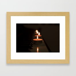 Candles on the piano Framed Art Print