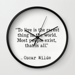 To live is the rarest thing in the world. Most people exist, that is all. Oscar Wilde Wall Clock