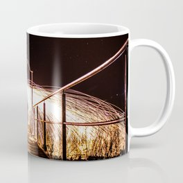 Fire umbrella made with lightpainting in a corridor under the sky full of stars. Coffee Mug