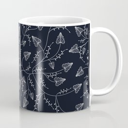 Delicate leaves on a black background . Coffee Mug