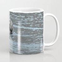 otters Mugs featuring Sea Otter Fellow by Alaskan Momma Bear