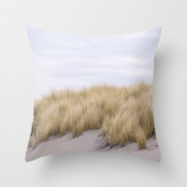 Field of grass growing in the sand Throw Pillow