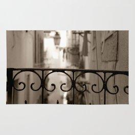 Lisbon street bokeh Rug