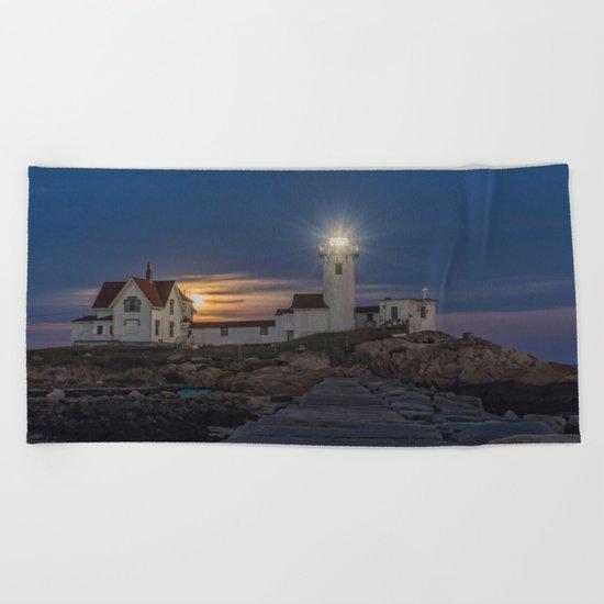 Full moon rising over Eastern point Lighthouse. Beach Towel