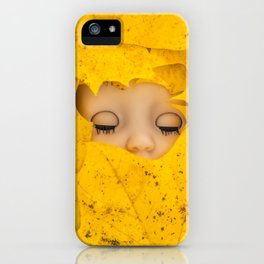 Moody, sleeping doll in vibrant yellow maple leaves iPhone Case