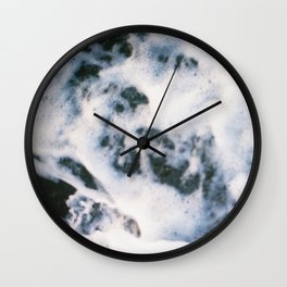Standing on the shoreline Wall Clock